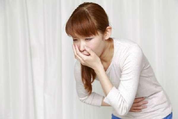 Вздутие и боль внизу живота: причины и лечение